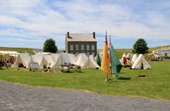 Several tents and flags set around the property during re-enactments of war, Fort Ontario, 2016 Royalty Free Stock Photos