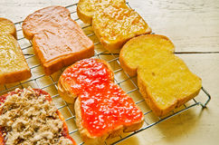 Several  toast with various topping Royalty Free Stock Photography