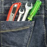Several tools. On a denim workers pocket Stock Photo