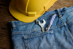 Several tools on a denim workers pocket Stock Images