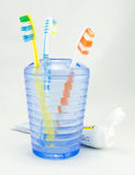 Several toothbrush put in storage and toothpaste Stock Images
