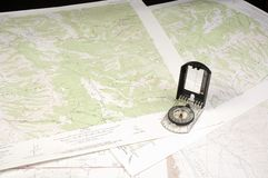 Several topo Maps and compass Stock Images