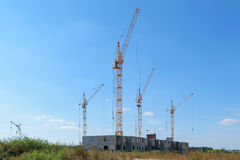 Several tower cranes building a new multi-storey panel house Royalty Free Stock Photo