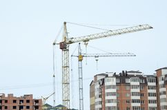 Tower cranes in operation. Natural colors and real photos stock photography