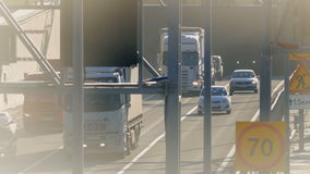 Several trucks and cars driving on the highway. Saint-Petersburg, Russia, 2016. Several trucks and cars driving on the highway in the afternoon stock video footage
