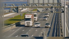 Several trucks and cars driving on the highway. Saint-Petersburg, Russia, 2016. Several trucks and cars driving on the highway in the afternoon stock footage