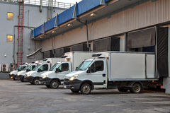 Several trucks in the loading dock at warehouse storage. royalty free stock image