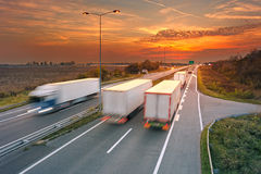 Several trucks in motion blur on highway Stock Images