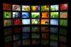 Several TVs with images. On black Royalty Free Stock Images
