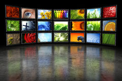 Several TVs With Images Royalty Free Stock Photo