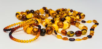 Several types of amber necklace. Several types of Baltic amber necklaces on a white background Royalty Free Stock Photo