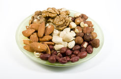 Several types nuts on saucer. Several types nuts mixed on saucer on white stock images