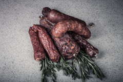 Several types of sausages on a light background Stock Photo