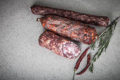 Several types of sausages on a light background.tinted Stock Images
