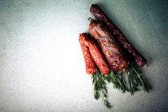 Several types of sausages on a light background.tinted Stock Photography