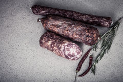 Several types of sausages on a light background.tinted Royalty Free Stock Photos