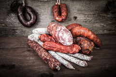 Several types of sausages on a wooden background Royalty Free Stock Photography