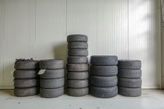Several tyre stacks in a garage royalty free stock photo