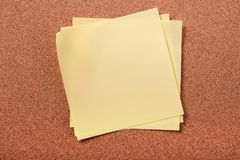 Several untidy sticky post notes on cork board background royalty free stock photography