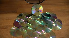 Several useless digital discs falling out of the dustbin. stock video footage