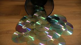Several useless digital discs falling out of the dustbin. stock video