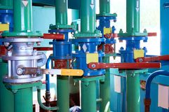 Several valves on the pipeline painted with green paint. Abstract background. Royalty Free Stock Photo