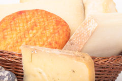 Several varieties of cheese in a wicker basket Stock Photos