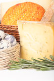 Several varieties of cheese in a wicker basket and basket quail Stock Photo