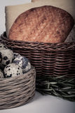 Several varieties of cheese in a wicker basket and basket quail Stock Photos