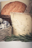 Several varieties of cheese in a wicker basket. tinted Stock Photos