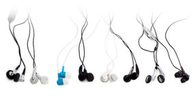 Several various earbuds on a light background Stock Photo