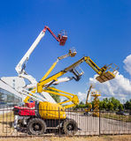 Several various self propelled articulated boom lift and scissor Royalty Free Stock Image