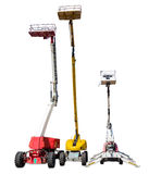 Several various self propelled articulated boom lift. Three various mobile aerial work platform - self propelled hydraulic articulated boom lift on light Stock Images
