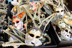 Several Venetian masks sold in the market Royalty Free Stock Images