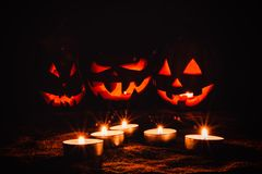 Several very scary Halloween pumpkins, with a menacing gaze and stock photos