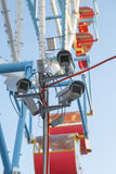 Several video cameras are monitoring the public order in the amusement park.  Stock Images