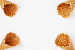 Several waffle cones lined in tower, smile, or even row, top vie Stock Photography