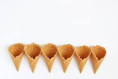 Several waffle cones lined in tower, smile, or even row, top vie Royalty Free Stock Images