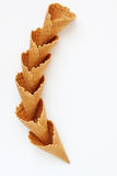 Several waffle cones lined in tower, smile, or even row, top vie Stock Images