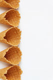 Several waffle cones lined in tower, smile, or even row, top vie Royalty Free Stock Photo