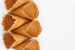 Several waffle cones lined in tower, smile, or even row, top vie Stock Photo
