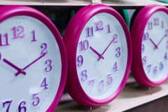 Wall clocks on the shelf Stock Photography