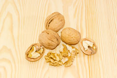 Several walnuts on a wooden surface Stock Image