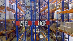 Several half-full warehouse rack rows in a front view. stock video footage