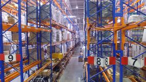Several warehouse racks in a side view sequence. stock video