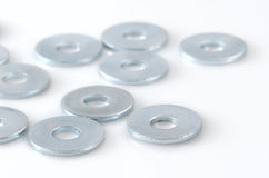 Several washers. Several metal screw washers isolated on white background Stock Image