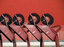 Several wheelbarrows in geometric position Stock Photos