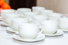 Several white coffee cups on  banquet Royalty Free Stock Image