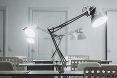Several white Desk lamps, office, office Desk lamps royalty free stock images