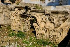 Ancient Greek Corinthian Columns Capitals, Athens, Greece. Several white marble Ancient Greek Corinthian column capitals resting on the ground, Acropolis slopes stock photo